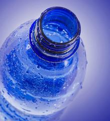 Plastic bottle of drinking water .