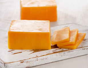 Cheddar Cheese on  wooden Cutting Board.