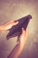 An empty wallet with filter effect retro vintage style