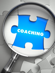 Coaching - Puzzle with Missing Piece through Loupe.