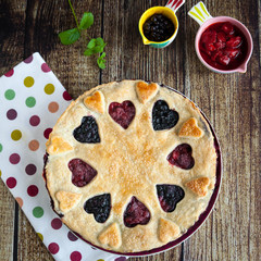Berry pie with strawberries and blueberries on wooden table