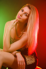 Beautiful woman between red and green bright lights