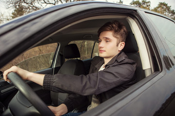 The young man behind the wheel,  traveling