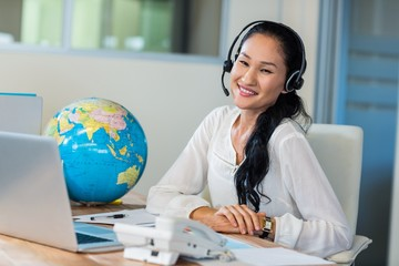Pretty travel agent smiling at camera