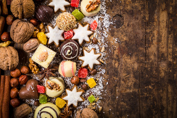 Wooden background with chocolate sweets