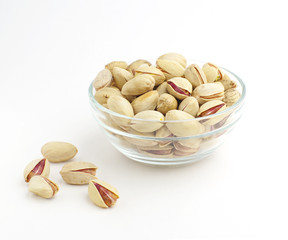 Inshell pistachio nuts in cup.