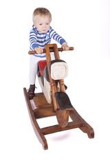 Boy and wooden motorbike