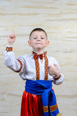 Child pointing up while wearing a folk costume