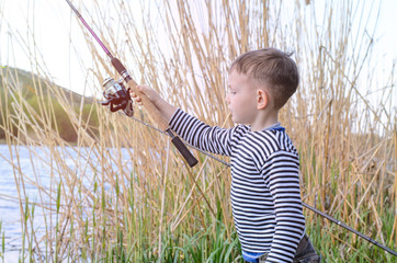 Handsome Young Kid Holding his Fishing Rod