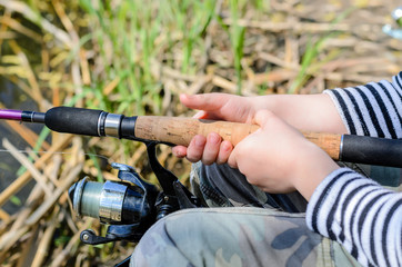 Young boy fishing with a spinning reel