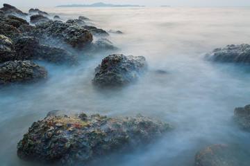 Long exposure of sea and stone seascape