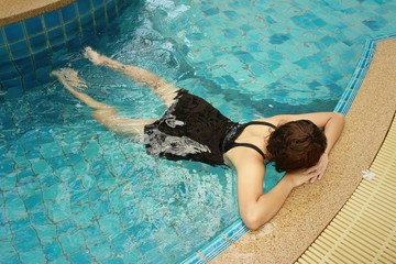 woman in a swimming pool at the hotel.