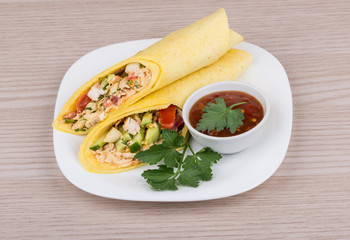 Shawarma with chicken and parsley in white plate, ketchup