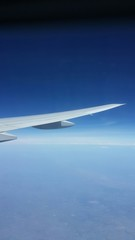 Plane's wing in the air