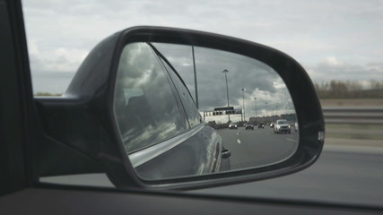 Side View Mirror Reflection Of The Road