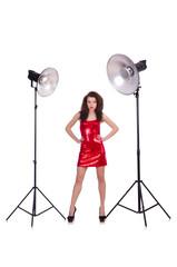 Woman in red dress posing in the studio