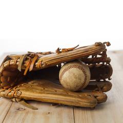 Old baseball glove with baseball
