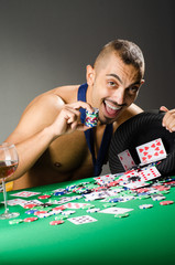 Man drinking and playing in casino