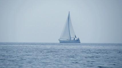 Sailboat on horizon