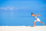 Fototapety Adorable little girl during beach vacation having fun