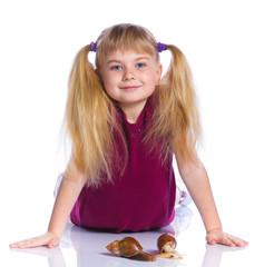 Little girl holding snails in hands