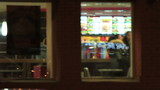 Windows of a fast food restaurant in the evening