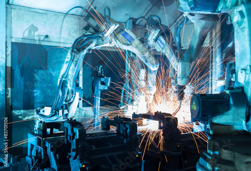 Poster welding robots  the movement. In the automotive parts industry.
