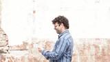 Man walking while writing message
