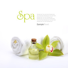 Spa concept. Green orchid, oil and white towels. © Zerophoto