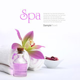 Fototapety Spa concept. Pink orchid, oil, potpourri and white towels.