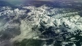 Aerial view over snow-capped Rocky Mountains, 4K