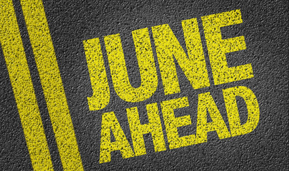 June Ahead written on the road
