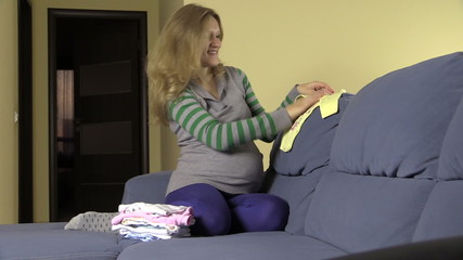 Pregnant woman pack hospital bag. Prepare for baby birth