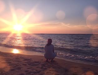 girl sitting on the beach.