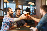 Fototapety happy male friends drinking beer at bar or pub