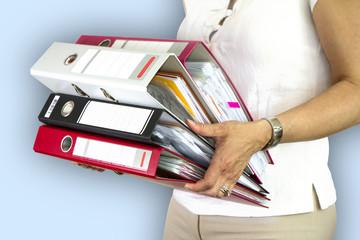 Secretary holding binders