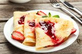 Fototapeta Pancakes with strawberry on plate on grey wooden backgound