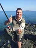 pescatore con sarago