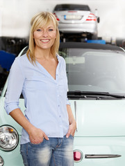 Woman is happy with the service in a garage