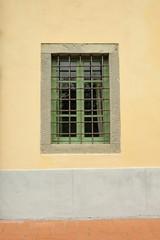 Old italian window with bars