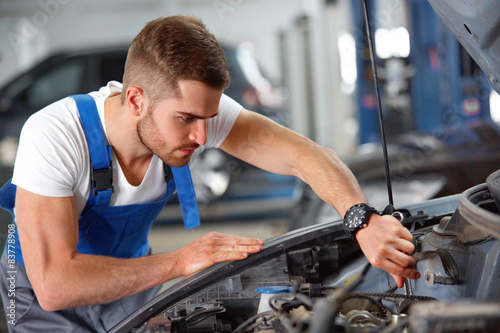 Portrait of a mechanic about to repair a car's engine