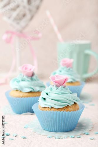 Tasty cupcake on pink background
