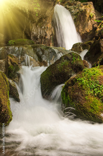 Plakat Beautiful small waterfall landscape in the mountains.