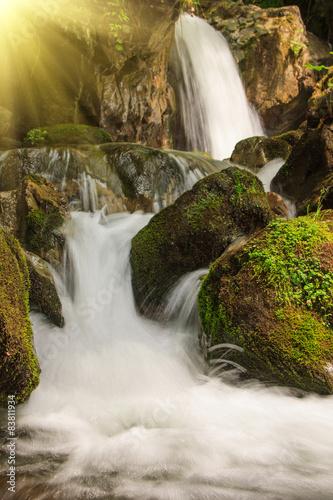 Fototapeta Beautiful small waterfall landscape in the mountains.