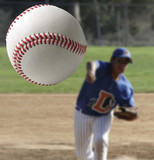Closeup of a baseball being pitched.
