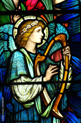Angel making music on a harp (stained glass) - 83900197
