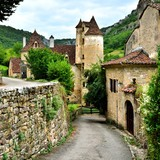Pretty lane through the village of Autoire, France - 83925167