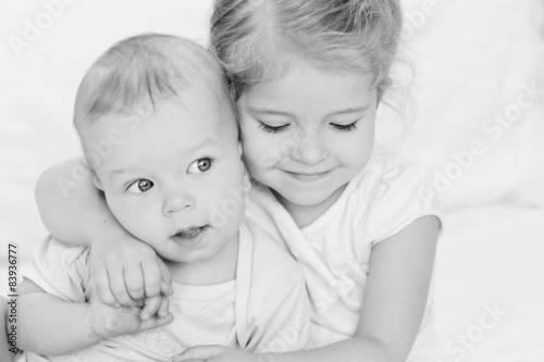 happy little sister hugging her brother © marchibas