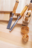 joinery chisels and woodworkers plane with shawings on wooden bo poster