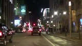 Time lapse of a bright city street at night